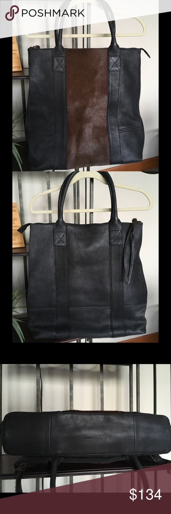 "🔆Beautiful ALLSAINTS Leather Polanski Tote Bag🔆 Beautiful ALLSAINTS Leather and Hair Polanski tote. Gently used. In excellent condition and shows very minimal wear. Color is black and brown. The lining is in perfect condition with no stains, rips, or tears (I pulled out to photograph - see pics). The Polanski Tote Bag is made using super soft leather with an Italian hair-on leather panel. Measures roughly 16"" tall, 16"" wide, handle height 8"". All Saints Bags Totes"