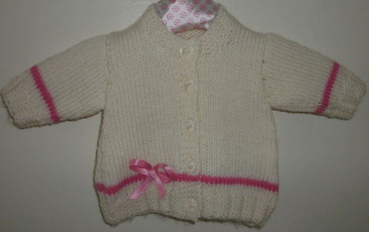 round necked cardi with ribbon and bead detail