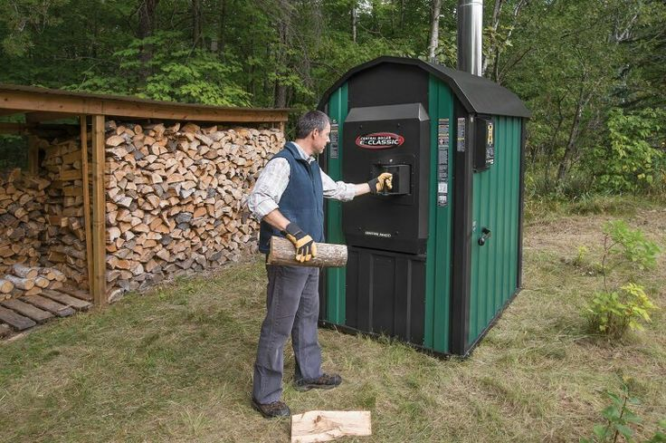 Outdoor wood burner with wood storage