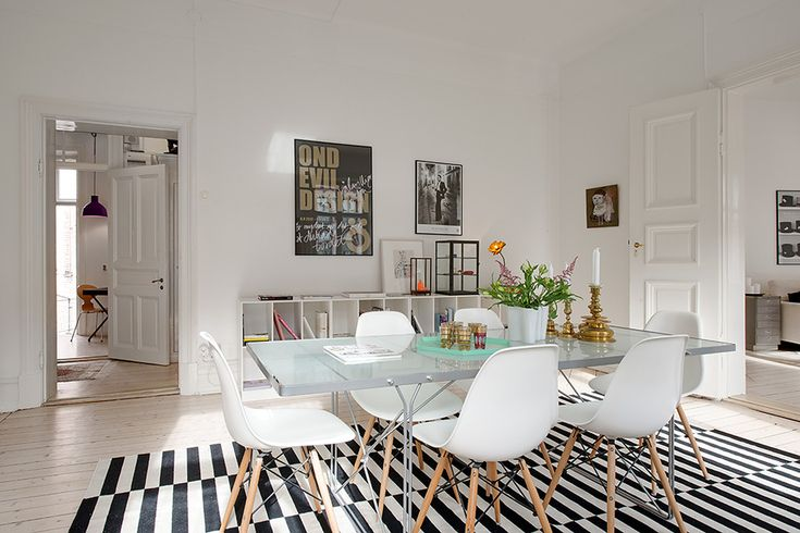 An apartment building in Sweden has kept all of its period detailing but appears new, fresh and modern with all the woodworking painted out white. Even the floor has...