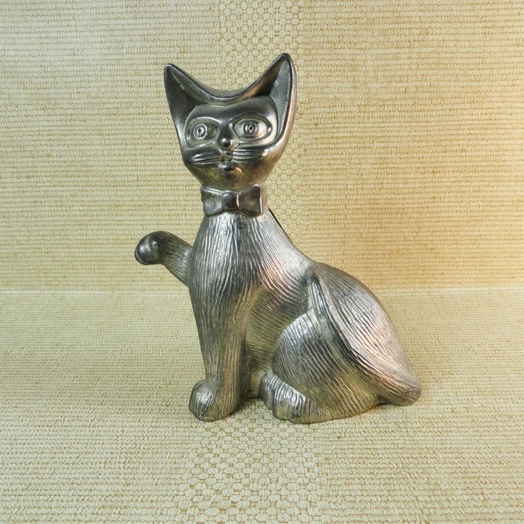 Vintage Lightweight Aluminum Cat Figurine Coin Bank - FOR SALE! Vintage lightweight aluminum siamese cat figurine coin bank with metal stopper disc. No key required. Made in Hong Kong. 5-1/2L x 2-1/2W x 6H. Buy Now