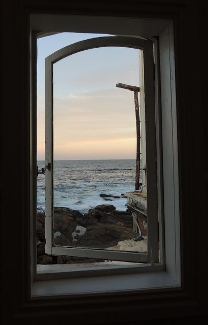 A window in a stairwell at The Harbour House restaurant in Kalk Bay, Cape Town, South Africa.