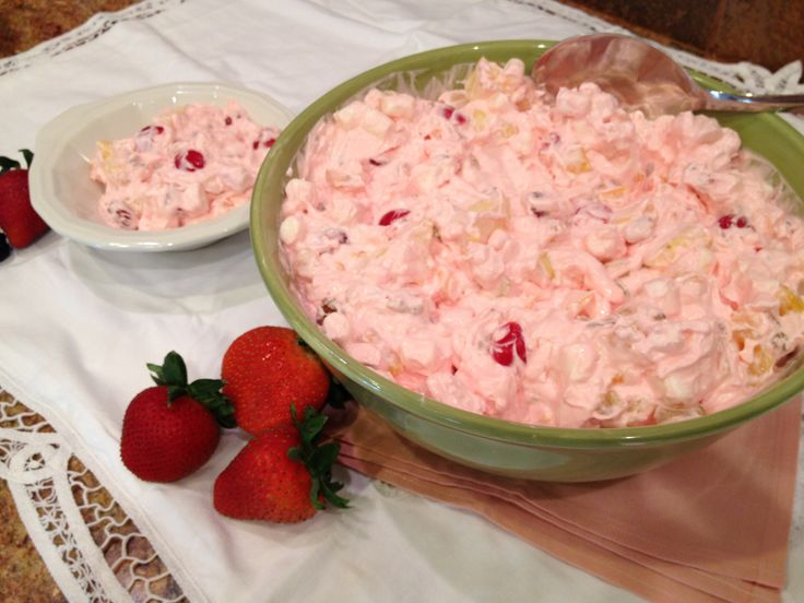 Cherry Fruit Salad - fabulous pink salad with maraschino cherries, pineapple, fruit cocktail, marshmallows and walnuts in a delicious cream cheese and cool whip base. This recipe is a keeper! At every family function... better known as nanny salad