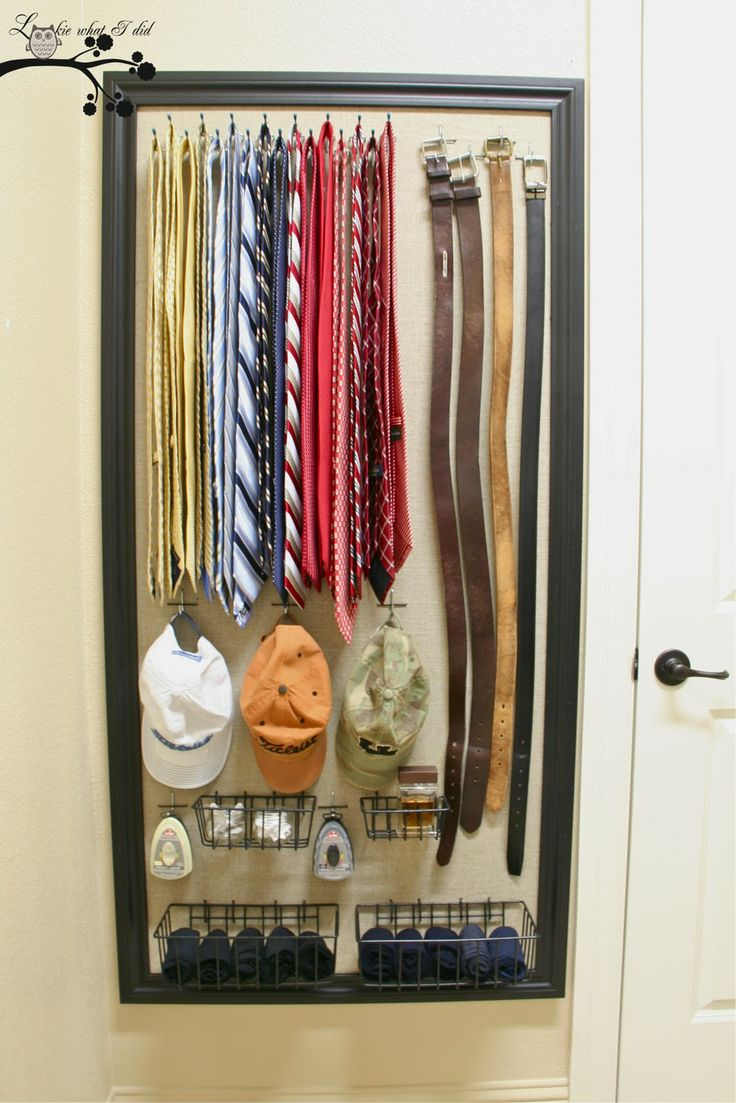 Lookie What I Did: A Closet Organizer for Him: cloth covered pegboard, hooks for ties, belts, shoe polishers, hats, baskets for socks, laundry stubs, accessory items