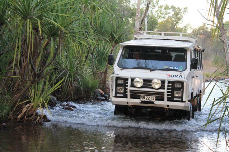 Sacred Earth Safari's OKA paddling through the creek at El Questro