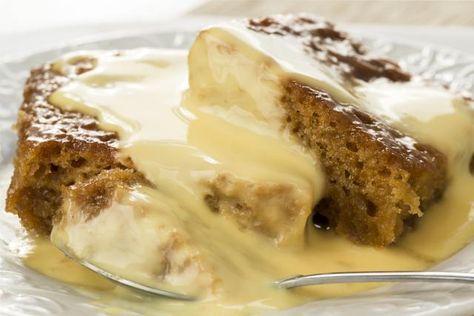 South African Dessert: Malva Pudding: Malva pudding, a traditional South African dessert covered with custard