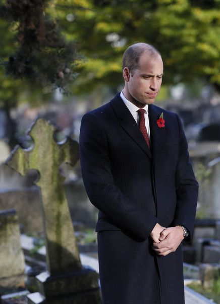 Prince William, Duke of Cambridge, as President of Fields in Trust, smiles as he arrives in the rain for a visit to the Willesden New Cemetery on November 10, 2016 in London, England.