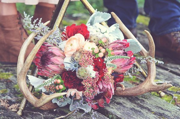 Antlers are perfect for creating beautiful centerpieces, just add some flowers and succulents, and maybe candles. Antlers can be used for place card holders or even favors, for decorating the venue or your wedding arch, for aisle decor and as cake toppers. Feeling creative? Use antlers as a base for your bouquet or even for your headpiece. Not convinced? Look at more ideas below and get inspired! http://www.deerpearlflowers.com/84-ways-to-use-antlers-for-your-rustic-wedding/