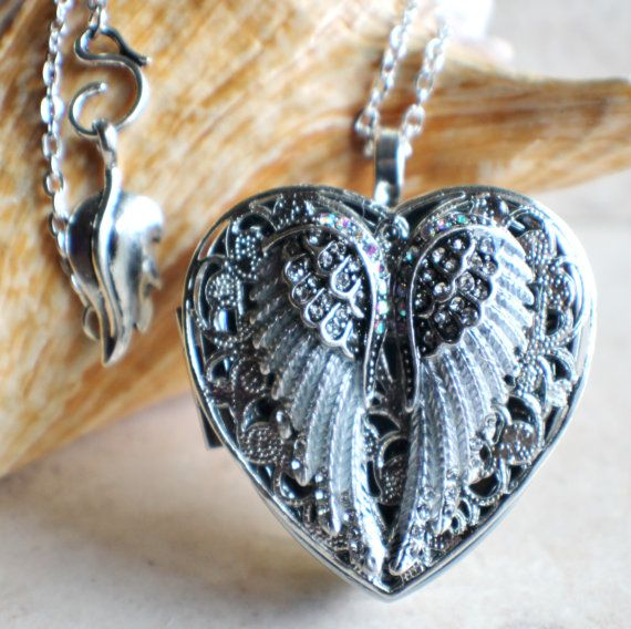 Angel+wing+music+box+locket++heart+shaped+by+Charsfavoritethings