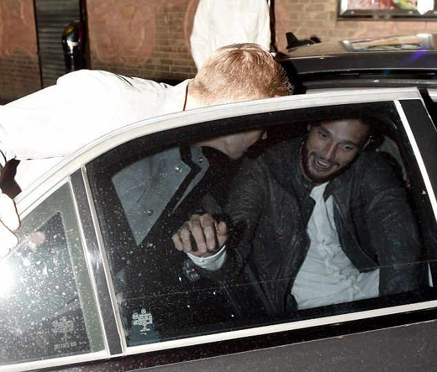 Off duty Andy Carroll looks excited to be out on the town with the striker currently out injured