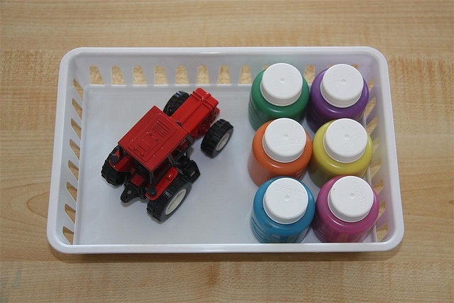 Tractor painting. We did this in the 2-yr-old room a couple of weeks ago and the kids really liked it. :)