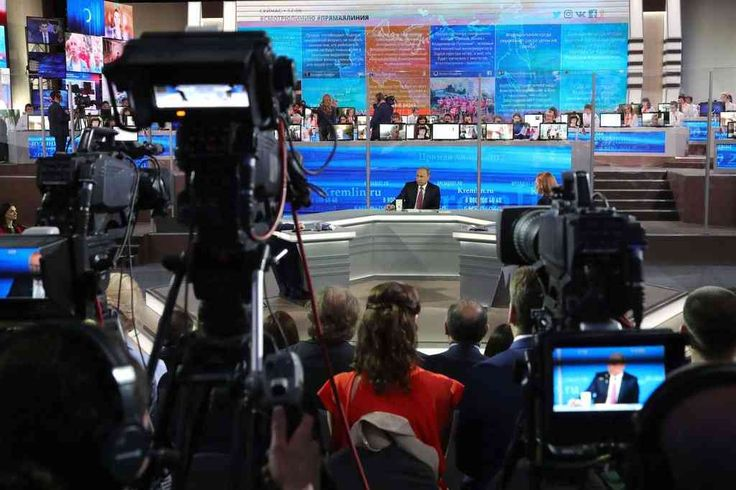 """President Vladimir V. Putin of Russia, center, answers questions at the Gostiny Dvor studio during the annual """"Direct Line with Vladimir Putin broadcast live"""" by Russian TV channels and radio stations in Moscow in June."""