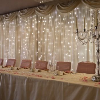 lighting and fabric to go behind the bar. This is gorgeous. I need to do my wedding all over again!