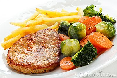 Fried meat with French fries and vegetable salad
