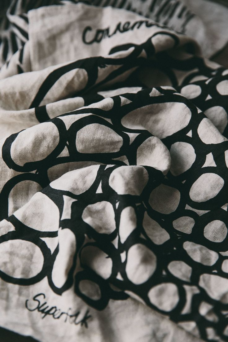 A tactile natural Irish Linen tea towel, hand screen-printed in small batch production.