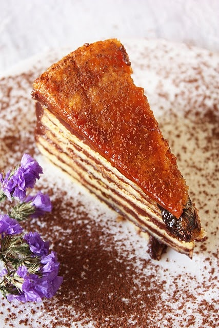 Dobos Torte. It is made out of 8 separately baked layers of biscuit spread over with a cooked buttercream.