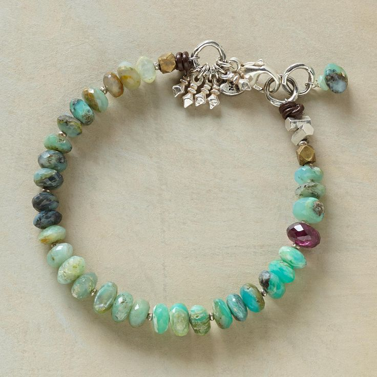 """DAWN PATROL BRACELET--In this opal and garnet bracelet, the varying shades of blue in Peruvian opal give way to one fiery garnet, blazing like the sun. Sterling silver lobster clasp. Exclusive. 7-1/4""""L."""