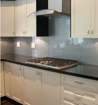 The big trend in backsplash material is glass -- love the color combination.