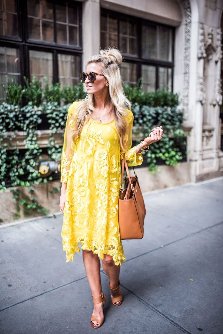 Yellow lace dress with bell sleeves for NYFW