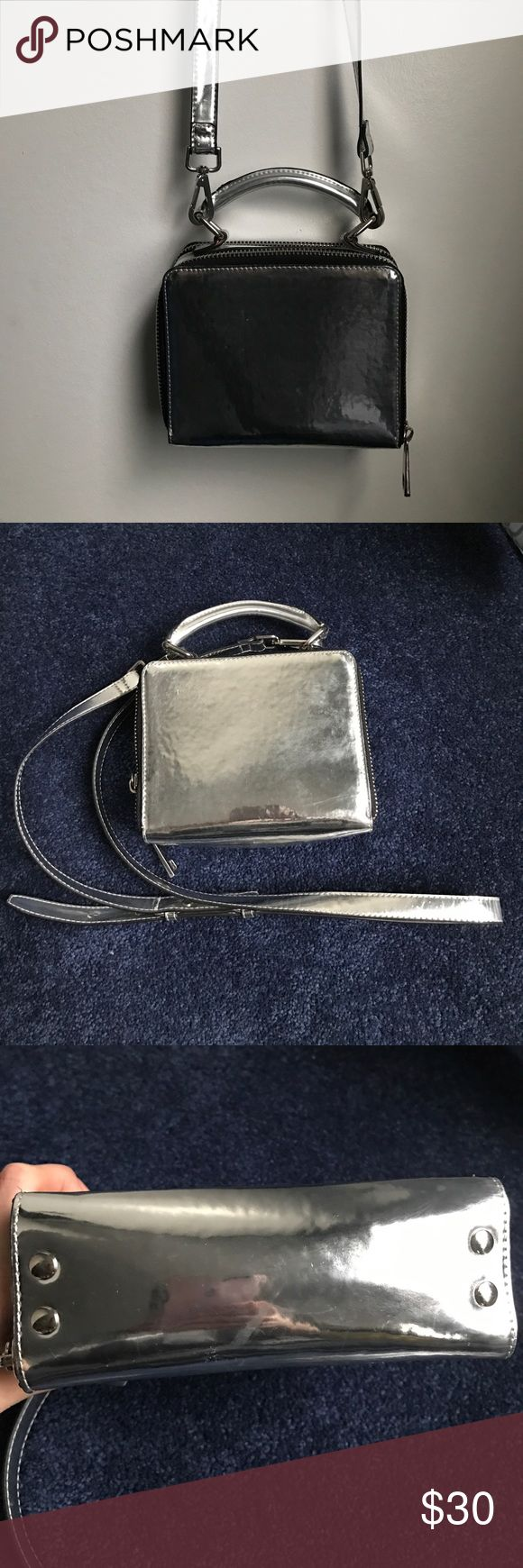 Topshop silver metallic purse bag Really good condition, some minor scratches because of the nature of the material -- removal strap Topshop Bags Crossbody Bags