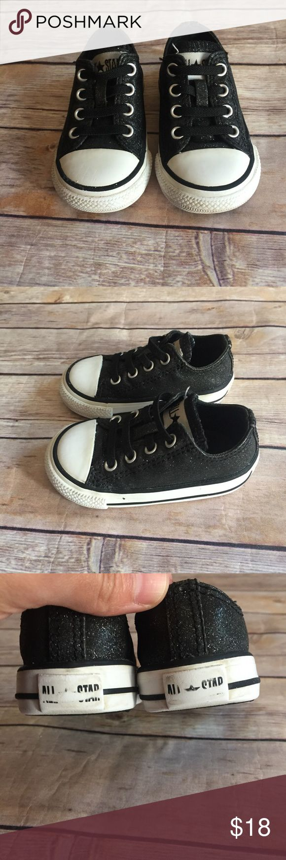 Converse Size 4 toddler black glitter converse in good used condition for wear to back logos.  Elastic laces for easy on and off. Converse Shoes