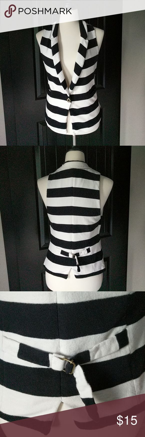 Cute black and white stripe vest. Versatile vest. Runs small in my opinion. Forever 21 Tops