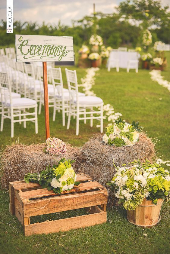 rustic country hay bale and wood crate wedding ceremony decor / http://www.deerpearlflowers.com/country-wooden-crates-wedding-ideas/
