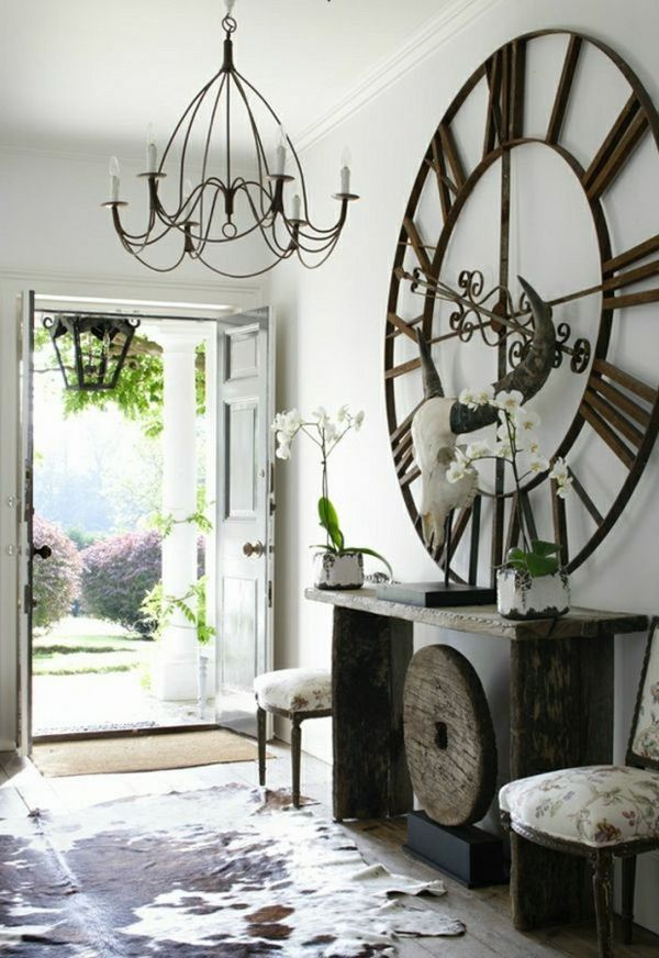 Vestibule decoration ideas console table wrought iron clock wrought iron chandelier