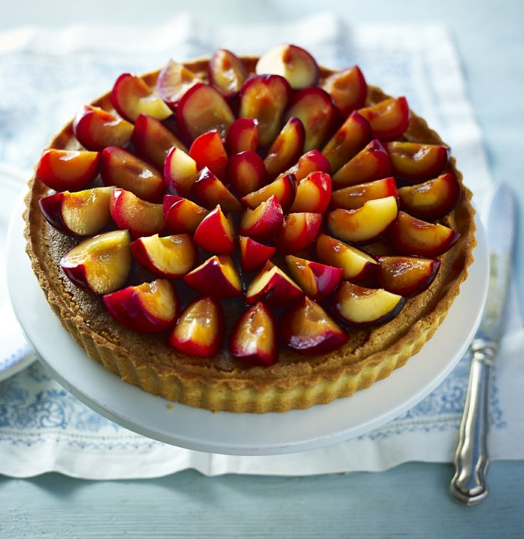 This plum tart will make an impressive finish to a dinner party. The fruit is preserved in jars ahead of being used to top a frangipane-filled pastry case.