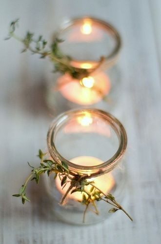 Votives with fresh thyme tied on. I imagine the scent would be so nice. Could probably do the same with rosemary too.