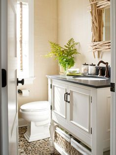 Store in Style Don't skimp on style when outfitting a small space with storage. Find solutions that blend beauty and function. In the bathroom, a vanity features storage for bath items in the cabinet and on an open shelf below. A pair of pretty glass canisters house cotton balls and swabs