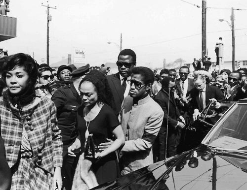 Bereaved celebrities Nancy Wilson, Eartha Kitt, Sammy Davis Jr., Sidney Poitier, Motown founder Berry Gordy Jr. and actor Marlon Brando proceed to Dr. King's funeral., Moneta Sleet Jr., Ebony Collection. April 1968...