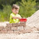 Haba beach toy bricklayer set - building a castle