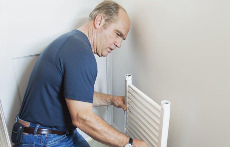 TOH's Richard Trethewey installing a flat-panel radiator