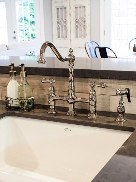 As seen on Fixer Upper, this brass faucet compliments the tile backsplash that appears in this kitchen.