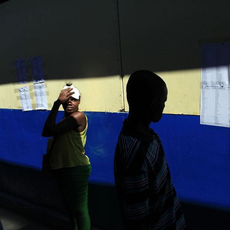 A voter looks for his name on a voters lists during elections in Port-au-Prince Haiti. The country is holding the first-round presidential vote Sunday along with balloting for numerous legislative races and local offices. #AP Photo by @ricardoarduengophotos  #elections #PortauPrince #Haiti #AssociatedPress #AP #photojournalism #RicardoArduengo by ap.images
