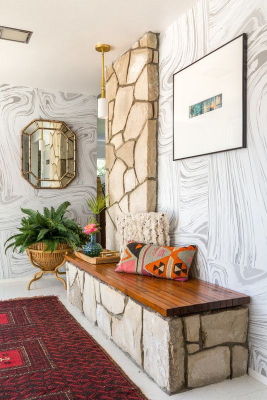 marbled wallpaper in an already textured entryway