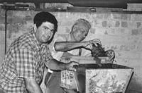 Egidio Friguglietti and Giovanni Sinisgalli making homemade wine at the Sinisgalli family home at 10 Carre Street Elsternwick