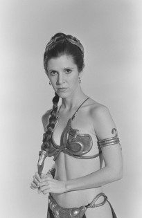 Carrie Fisher models Slave Leia costume