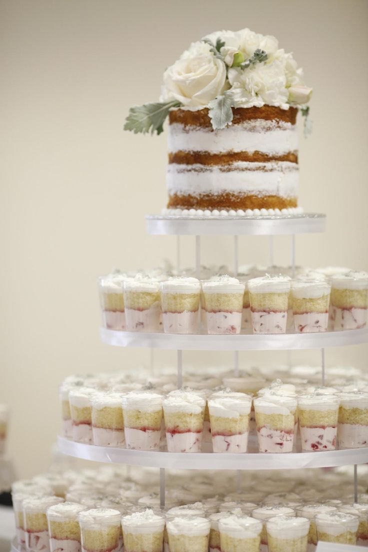 Strawberry cream cupcake shooters and naked cake, placed on a cupcake tree display. By A Cake Life - www.acakelife.com