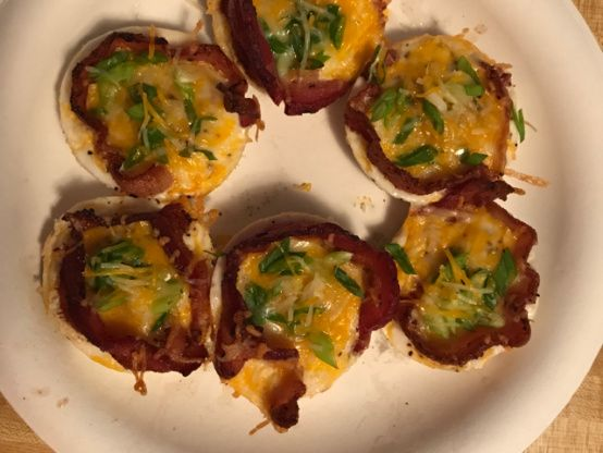 This is a simple recipe that my husband makes for us a lot for breakfast.  Just takes one pan and you have bacon and eggs! This recipe easily adapts to how many you want to make, just use more muffin/cupcake pans!  Now if you like to have your bacon crispy, this will not be for you.  The bacon gets done but not crispy! The bacon flavors the egg, which is much like a poached or boiled egg. The servings are based on two bacon and egg cups per person. Hope you enjoy!