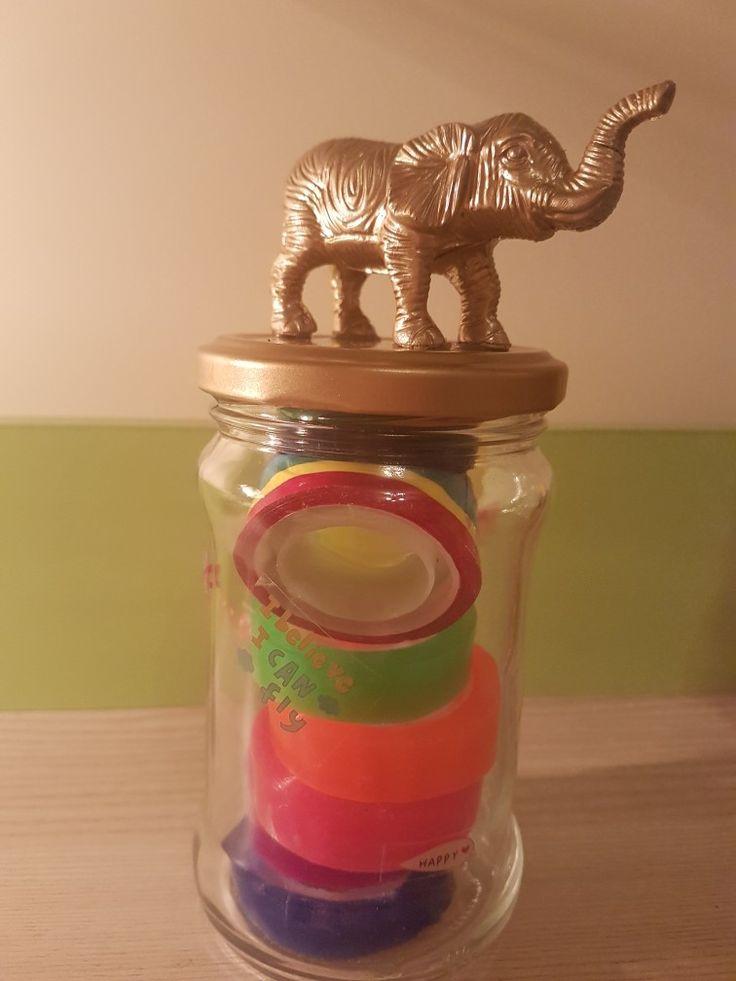 Jar, gold elephant