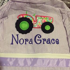 Buyer photo Claire  using Original Stitches Tractor Applique design.