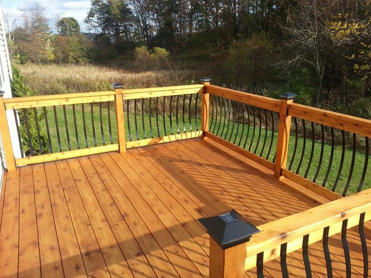 Best Knotty Cedar Deck With Wrought Iron Spindles And Solar 640 x 480