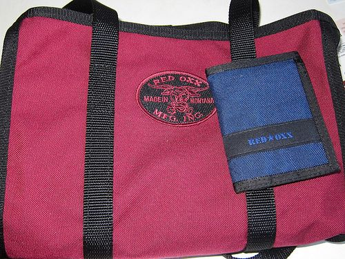 http://www.howtogetcheapairlinetickets.net/carry-on-restrictions.html Carry on luggage restrictions for all airlines. Rigger Wallet on top of Market Tote