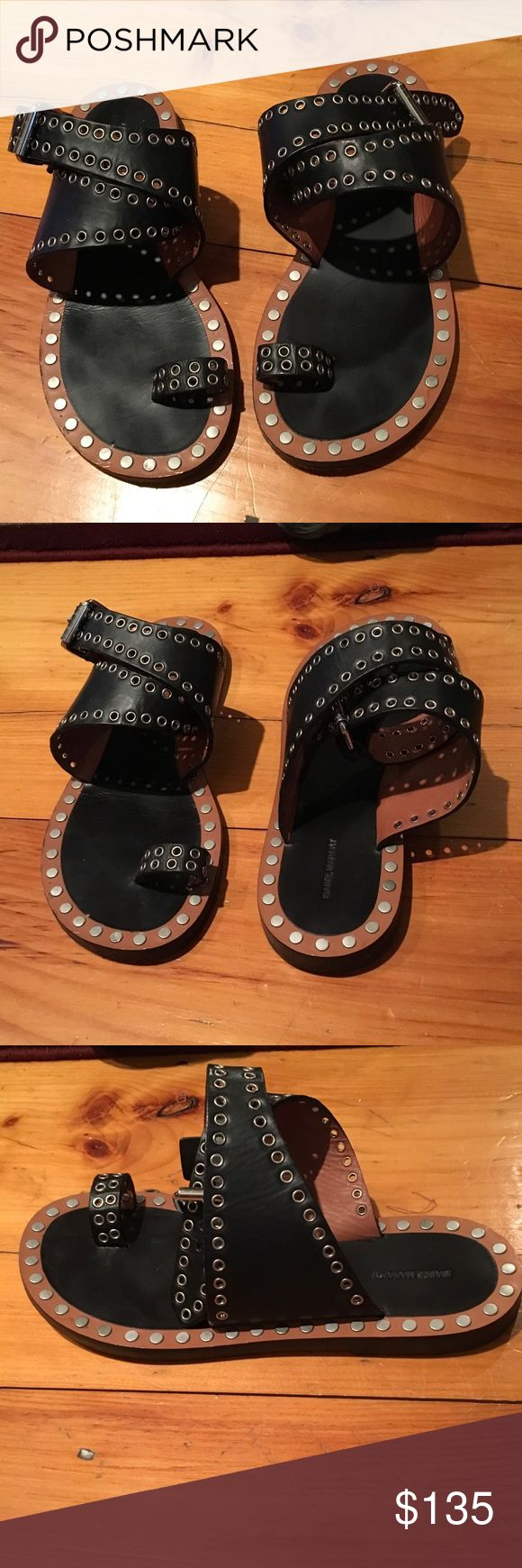"""Isabel Marant Black Wrap Sandals Isabel Marant Black Leather Ankle-Wrap Sandals. Size 8. Gold-Tone Hardware, Grommet Embellishments Throughout Uppers, Rivets at Soles. Stacked Heels, and Buckle Closure at Ankle Wrap. Heel Measures 0.5"""". Worn Once. Isabel Marant Shoes Sandals"""