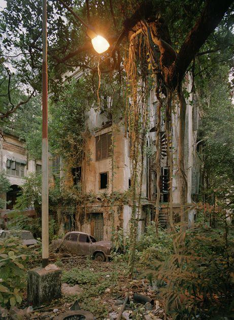 KOLKATA HERITAGE PHOTO PROJECT.  Derelict Ambassador next to seemingly abandoned building, Kolkata