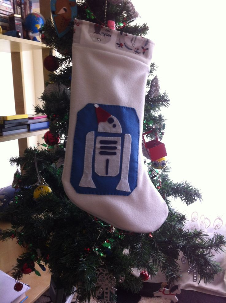 R2D2 Christmas stocking  Made from fleece, calico as the inside lining and felt for the R2D2  No stencils used just scissors on felt.