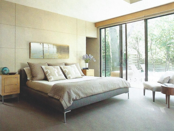 bedroom: wood paneling, bed frame window wall
