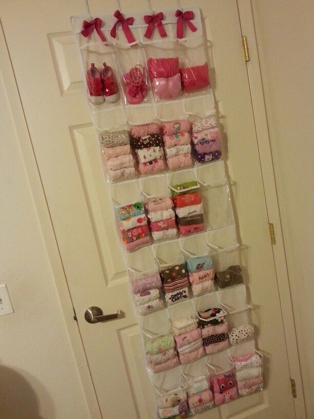 Baby clothing storage using an over-the-door shoe organizer. I did this & love the idea because everything you have is displayed, making it easy to find whatever you're looking for. Plus we live in a 1bdrm apartment, so it's perfect for saving space!
